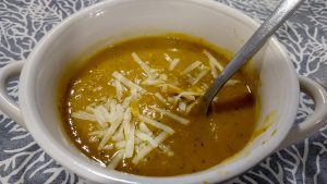 leek, zucchini and sweet potato soup topped with grated parmesan cheese